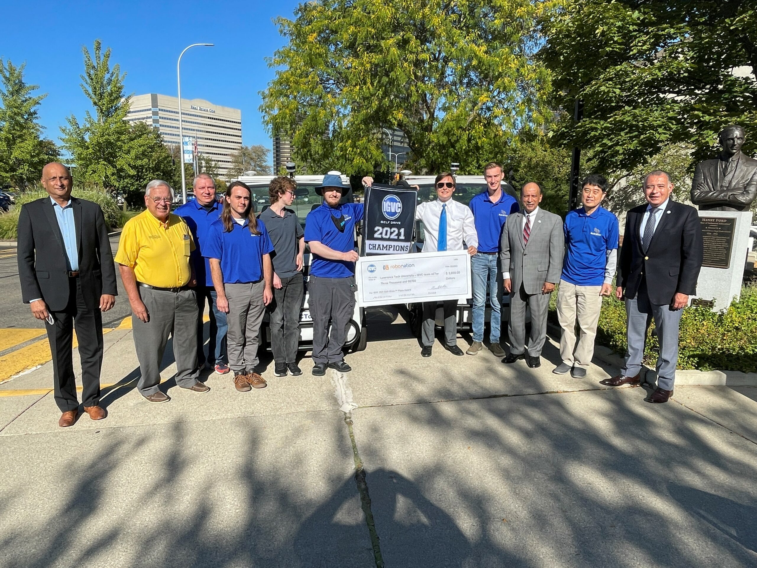 Lawrence Tech IGVC team receives the RoboNation 2021 Self-Drive champions banner, $3,000 award