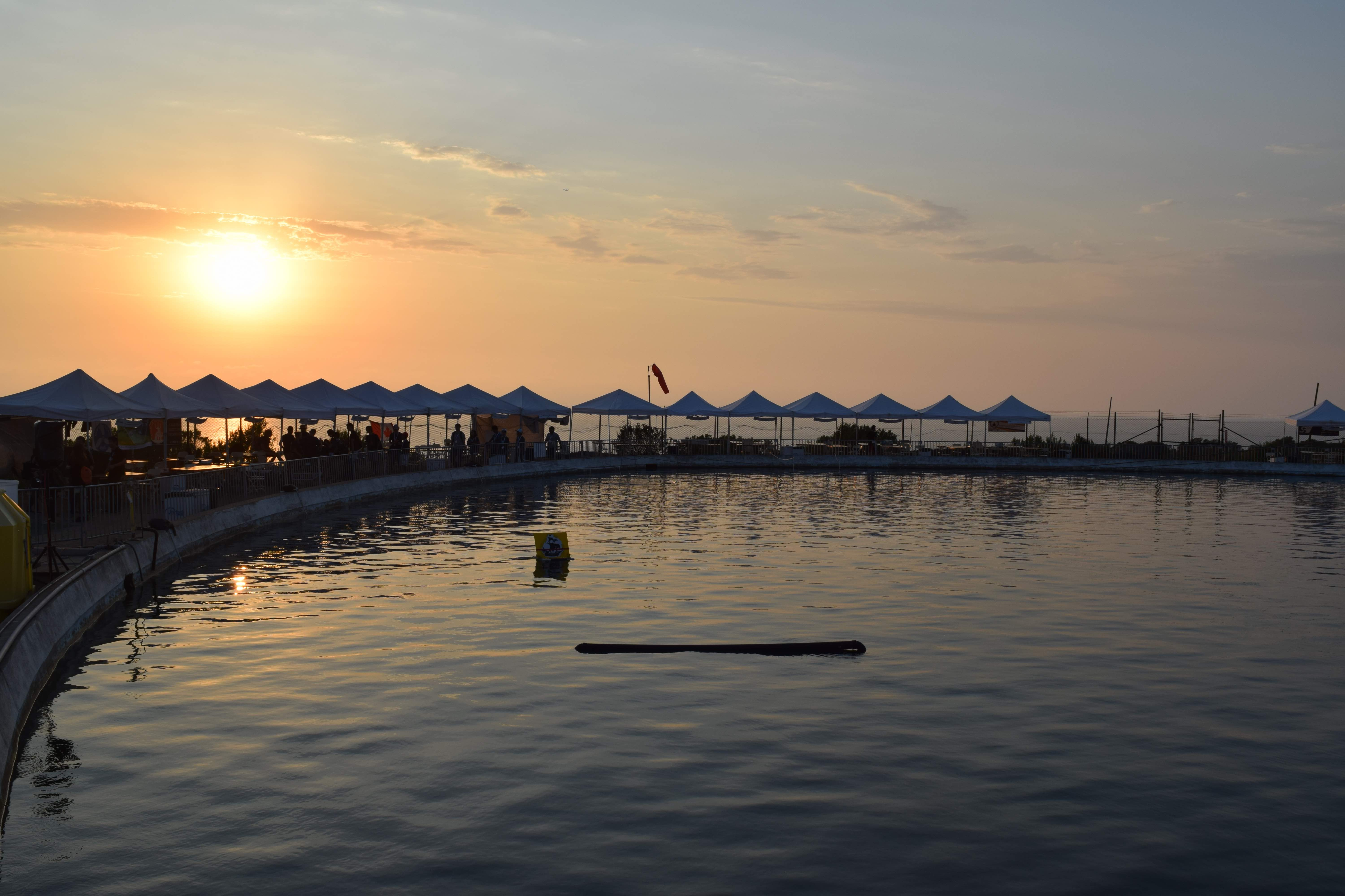 sunset over water at competition site